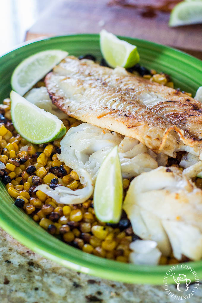 When the fish is done, set it on a plate right next to the grill, and set up a foil tent that funnels heat from the hot side of the grill down onto the fish to keep it warm.