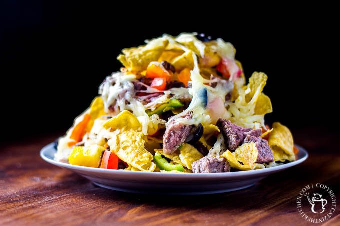 """Tired of the same old taco on your """"Taco Tuesday"""" nights? Give these easy loaded baked nachos a try! They're bright, filling, and easy as pie!"""