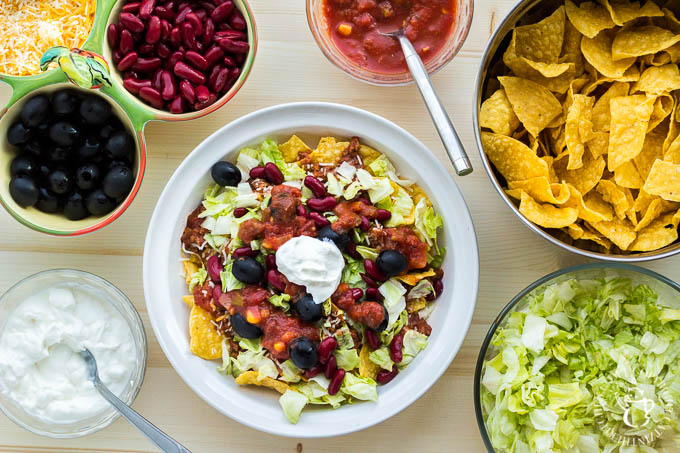 """This recipe for """"trainwreck"""" taco salad is simple, inexpensive, easily customizable, and incredibly tasty! It will please your family, or a crowd of almost any size!"""