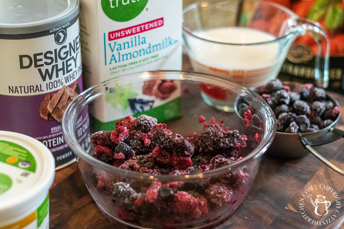 We stumbled upon this one by accident! Intending to make something else entirely, we ended up with this yummy chocolate covered blueberry protein smoothie!